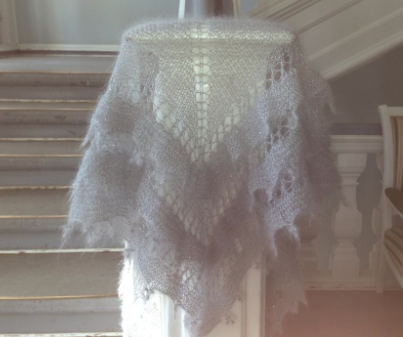 White Loose Knit Shawl Overhanding Stairway Banister