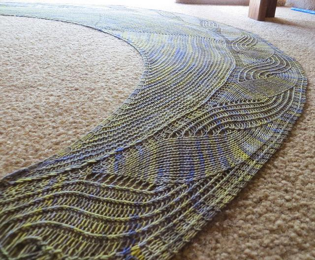 Colorful Shawl Laid out on Rug