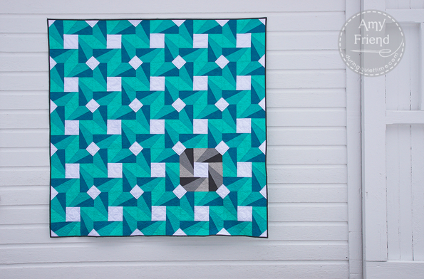 Green, Blue and White Quilt with Spinning Wheel Design