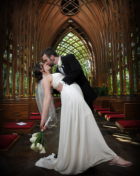 Bride and Groom Kissing in Beautiful Church