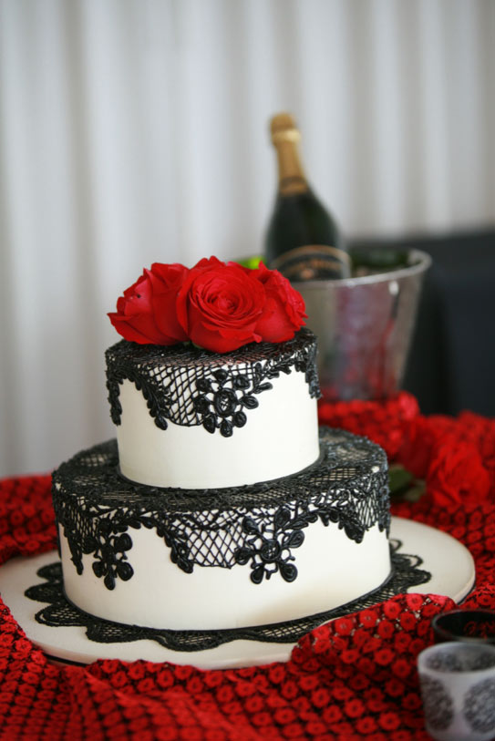 White Cake with Black Lace and Red Flower Toppers
