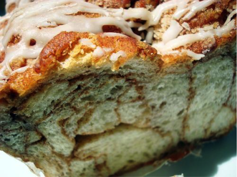 Cross Section of Bread Pudding with Cinnamon Veins, Drizzled in Icing