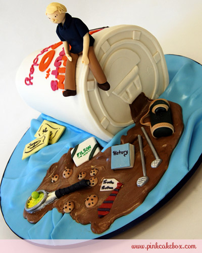 Cake Shaped Like Spilled Coffee with Various Objects in It