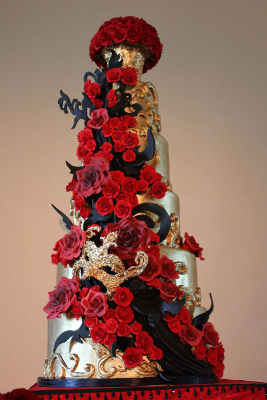 Tiered Shimmering Cake Covered with Red Roses