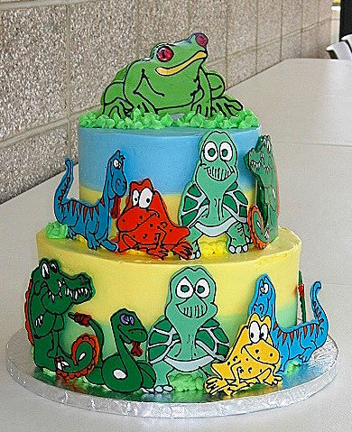 Tiered Cake Decorated with Reptile Cutouts
