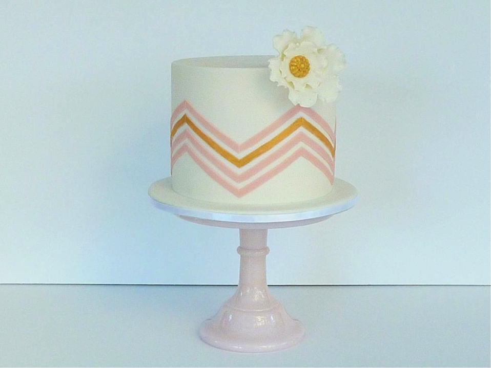 White Cake with Pink and Orange Chevron Stripes and Flower
