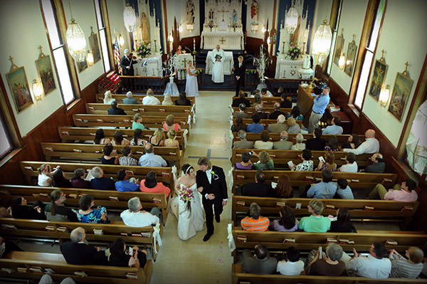 Photo of Bride and Groom Walking Down Aisle at Church