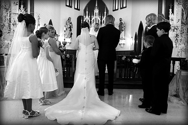 Black and White Photo of Couple Standing at the Alter