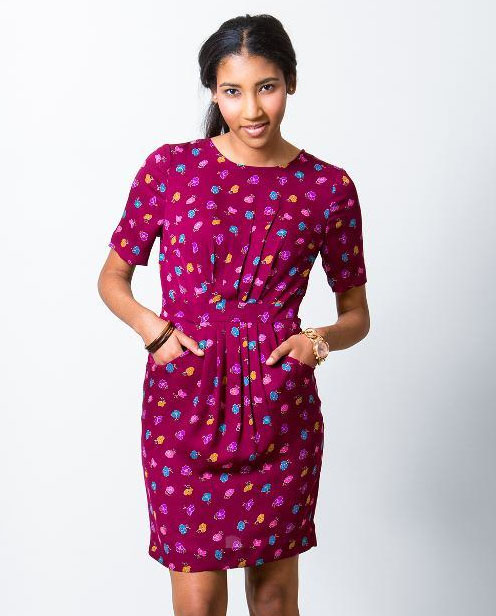 Young Woman Wearing Dark Pink Patterned Dress