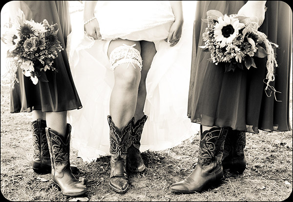 Shot of Bride's and Bridesmaid's Legs Wearing Cowboy Boots
