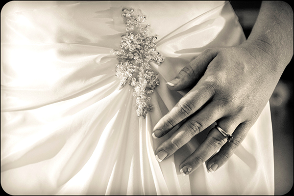 Wedding Dress and Wedding Ring Detail Shot