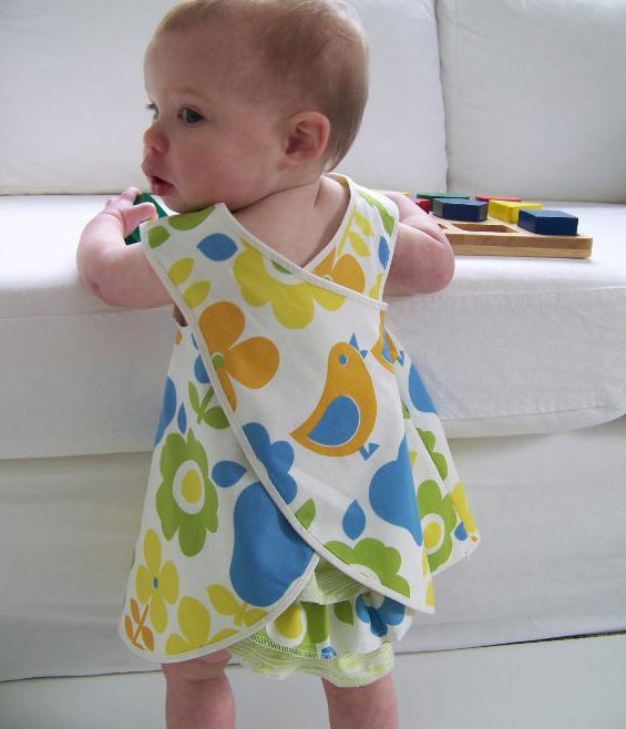 Baby Girl Wearing Colorful Pinafore Dress
