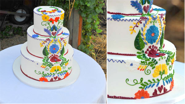 White Tiered Cake with Vibrant Design
