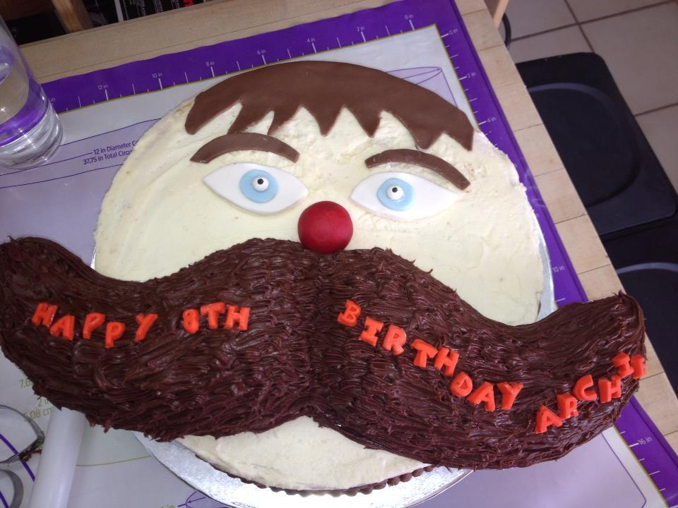 Birthday Cake in Shape of Face with Large Mustache