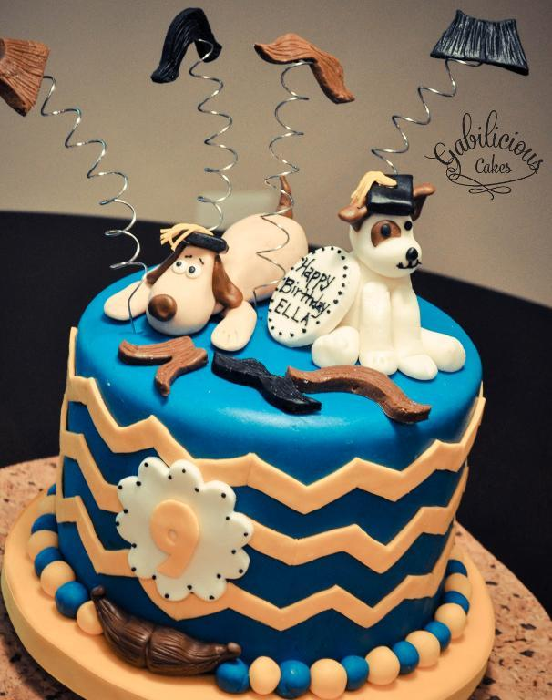 Blue Cake Topped with Dogs and Mustaches on Springs