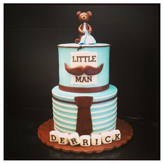 "Blue Tiered Cake Topped with Bear, Reading ""Little Man"""