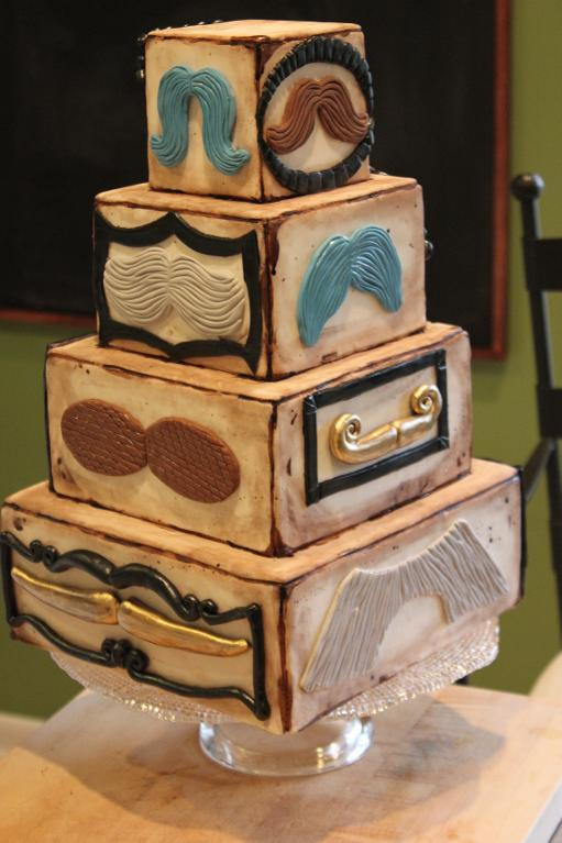 Tiered Cake Featuring Different Varieties of Fondant Mustaches