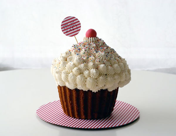 Cake in Shape of Giant Cupcake with Cherry on Top