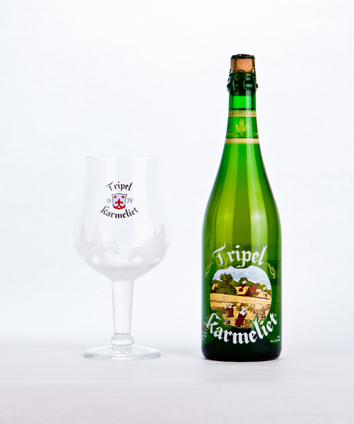 Green Bottle of Beer (Full) Next to Clear Glass Goblet