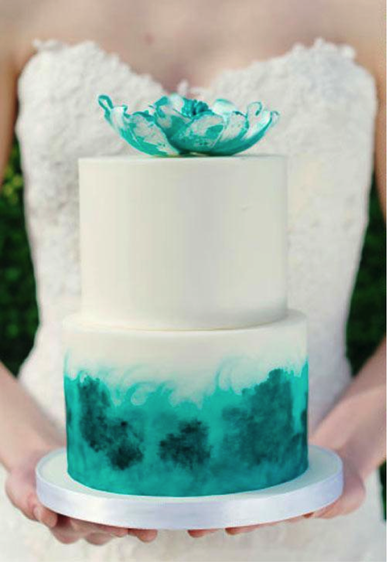 Woman Holding Tiered Green Cake