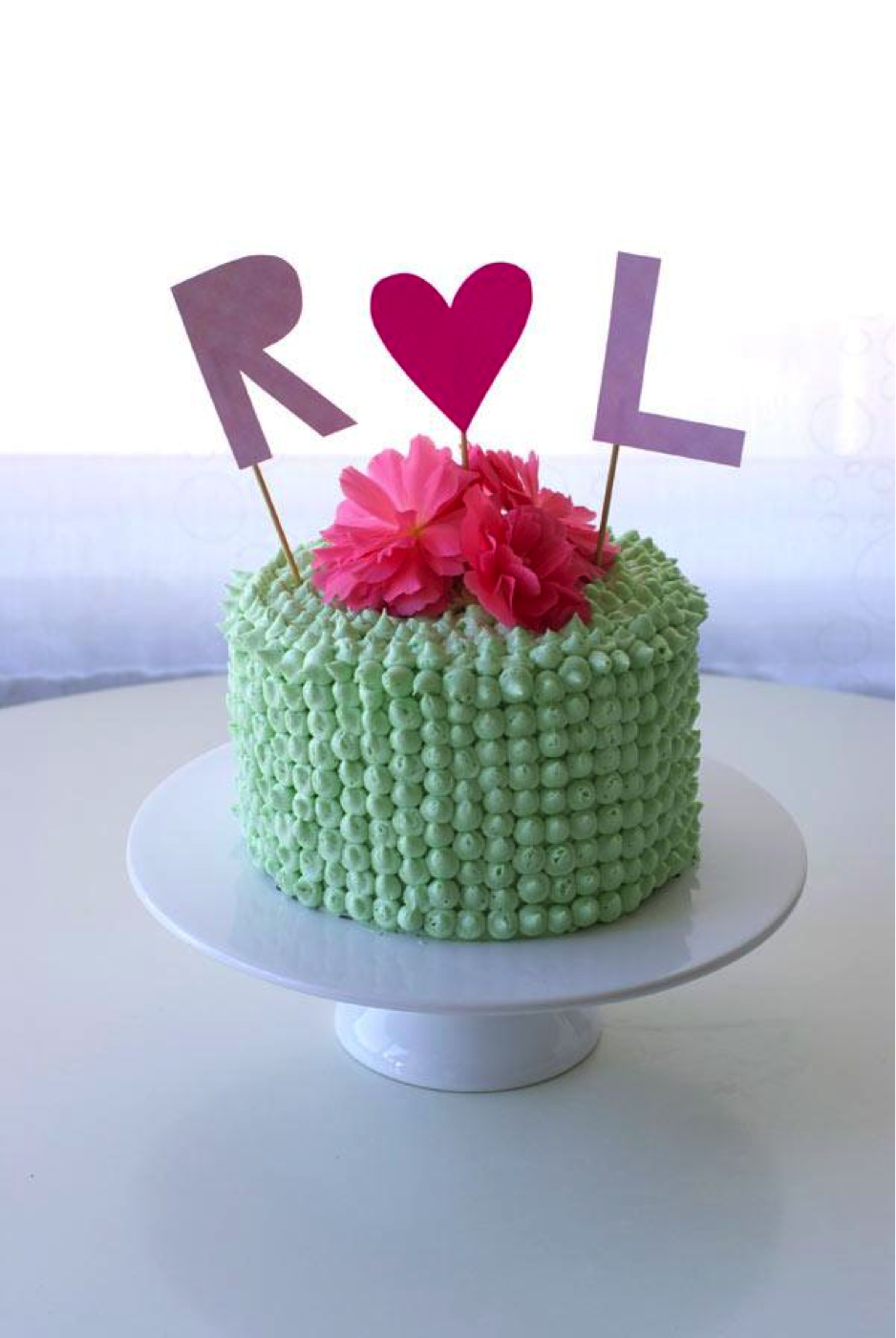 Mint Buttercream Cake Topped with Pink Flowers