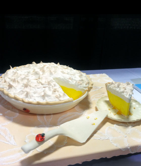Cake in Shape of Lemon Meringue Pie with Slice Cut Out