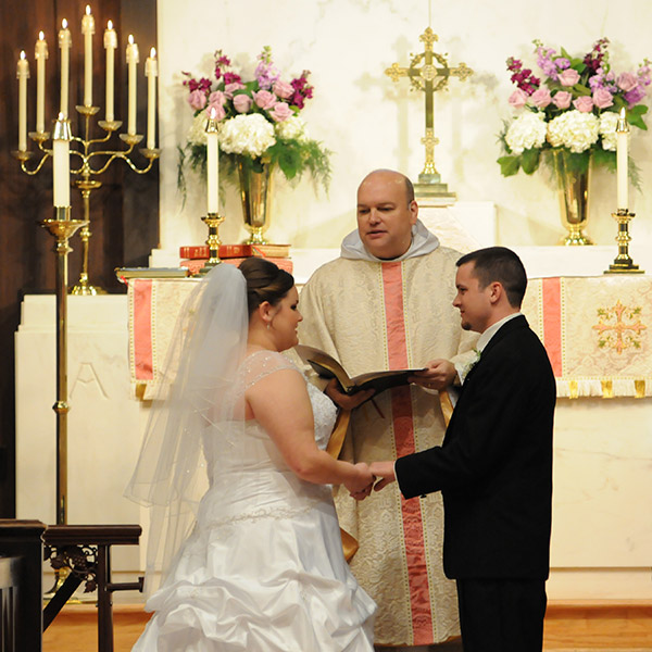 Bride and Groom at Altar with Priest