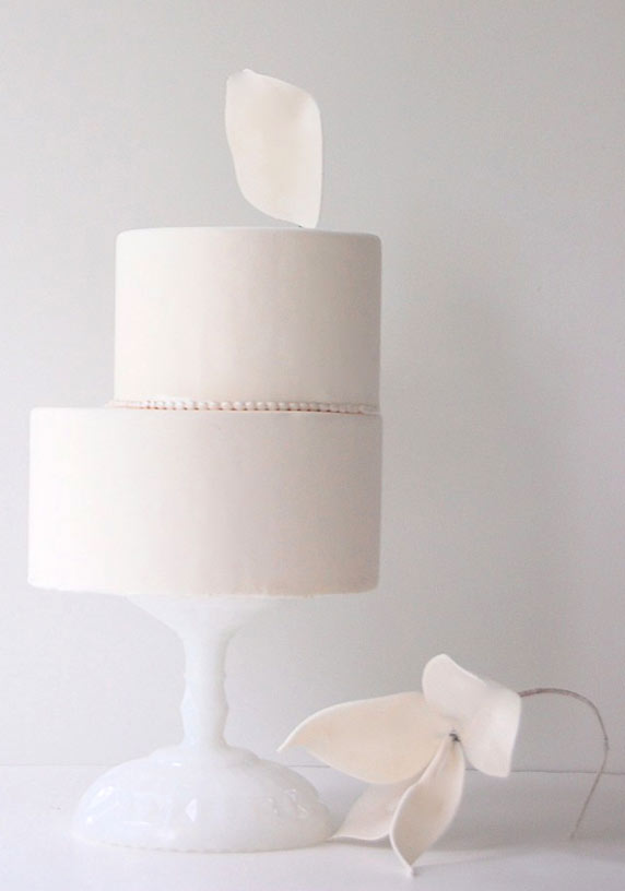 Two Tiered Off-Centered White Cake with Pearls