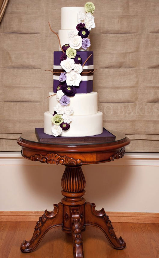 5-Tier White Wedding Cake with Purple Flowers and Present Insert
