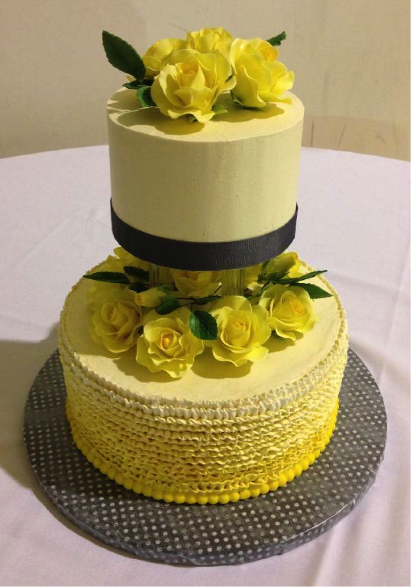 Yellow Ombré Wedding Cake Topped with Flower
