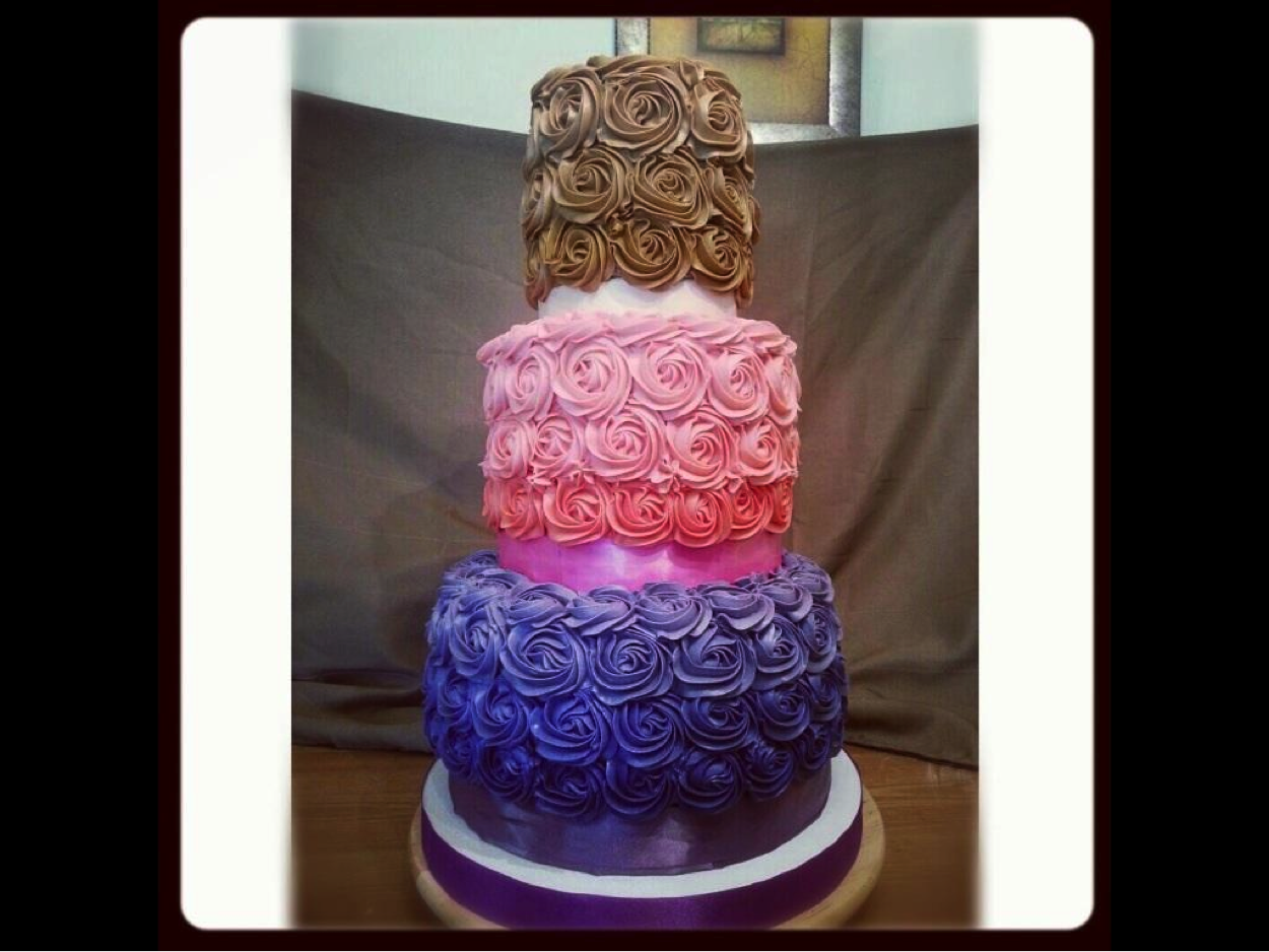 Tiered Cake Covered in Multicolor Icing Roses