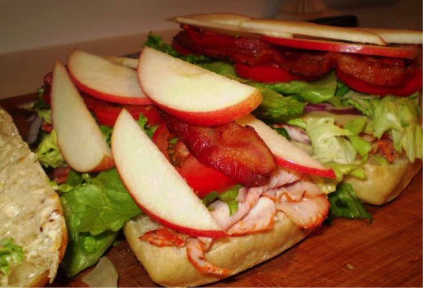 Apple, Bacon, Lettuce and Turkey Stacked High on Bread
