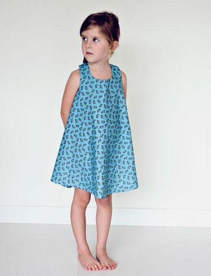 Little Girl in Blue Patterned Dress