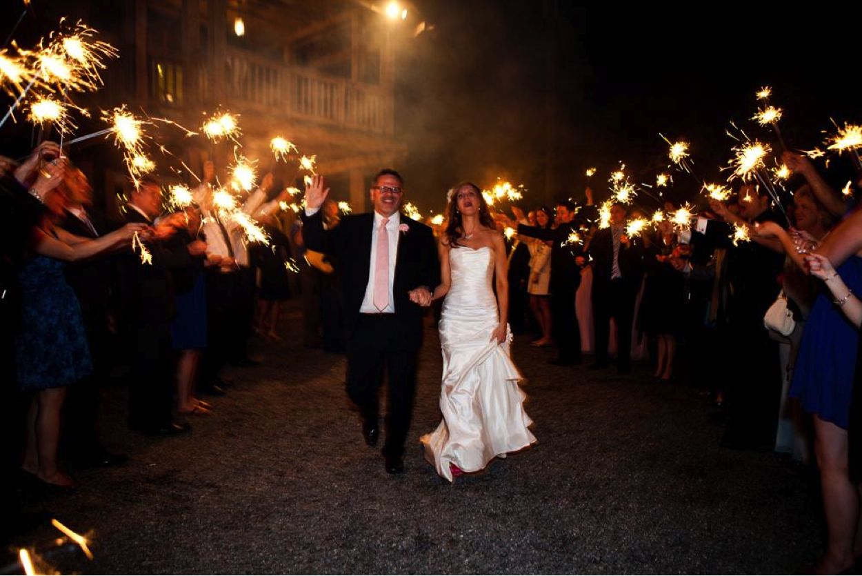 Wedding Couple Walking Through Crowd with Sprinklers