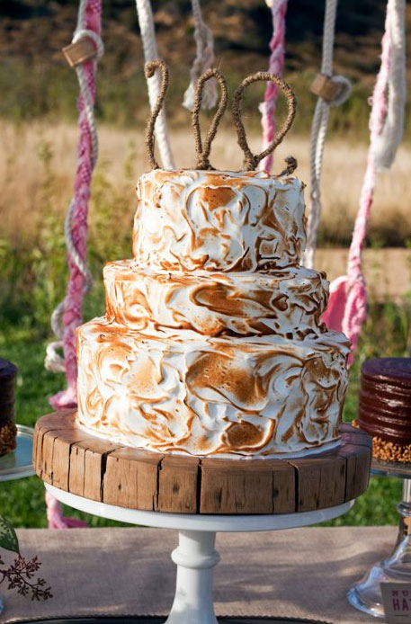 Tiered Toasted Meringue Covered Wedding Cake with Decorative Topper
