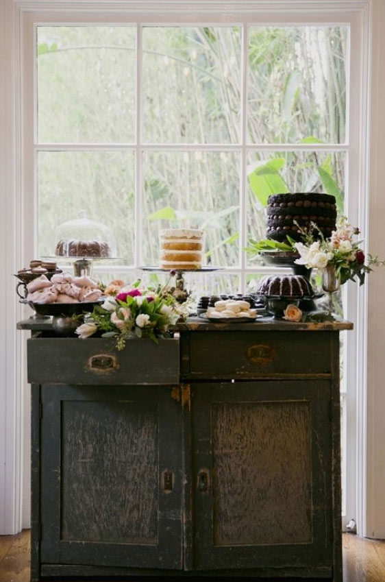 Rustic Table Featuring an Array of Desserts and Decorations