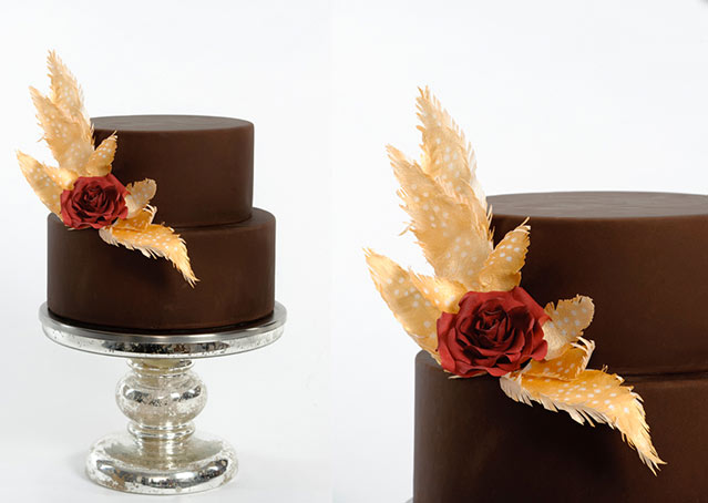 Two-Tiered Chocolate Wedding Cake with Gold Leaves and Red Bow