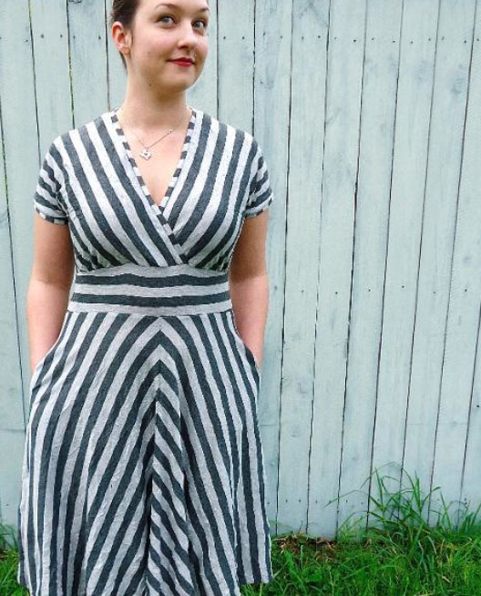 Woman Wearing Striped Dress and Smiling