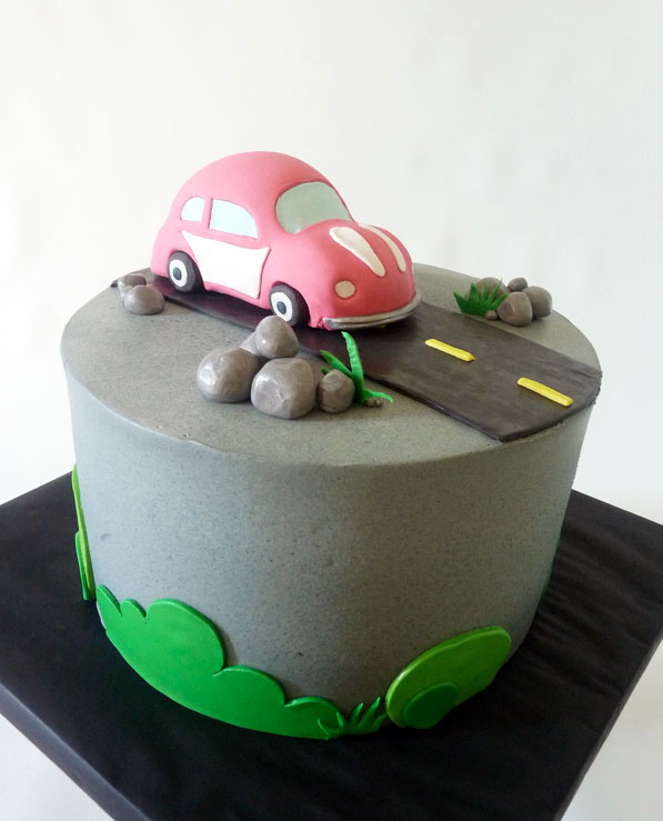 Cake Featuring Little Red VW Bug on Road