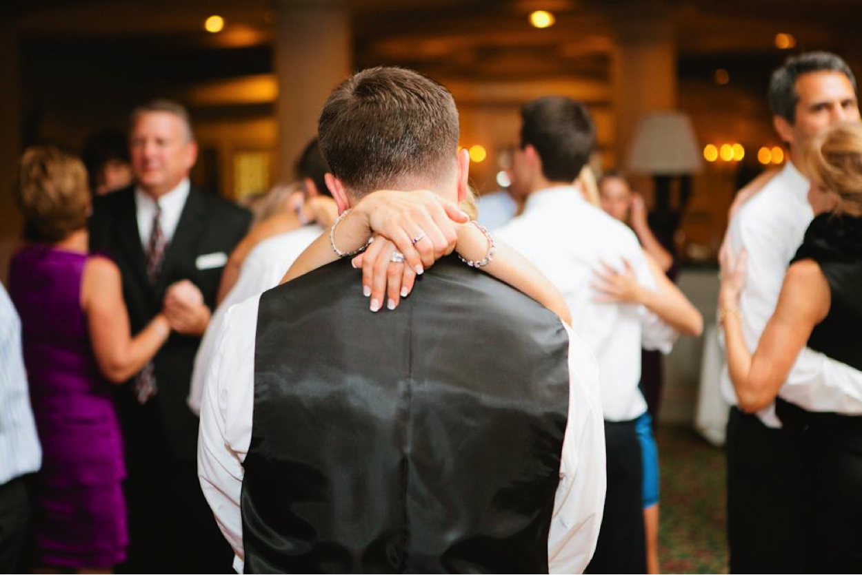 Bride with Arms Around Groom on Dancefloor