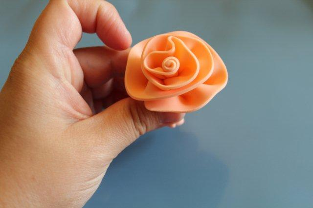 Hand Displaying First Layer of Fondant Rose