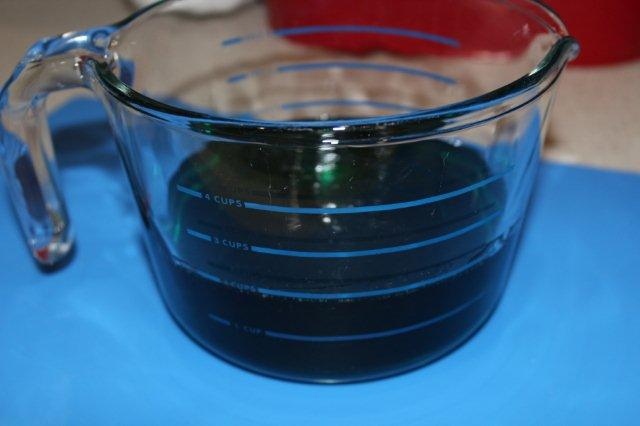 Measuring Cup Filled with Green Liquid Sugar