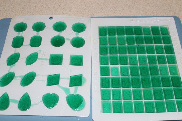 Plastic Sugar Molds Filled with Green Liquid Sugar