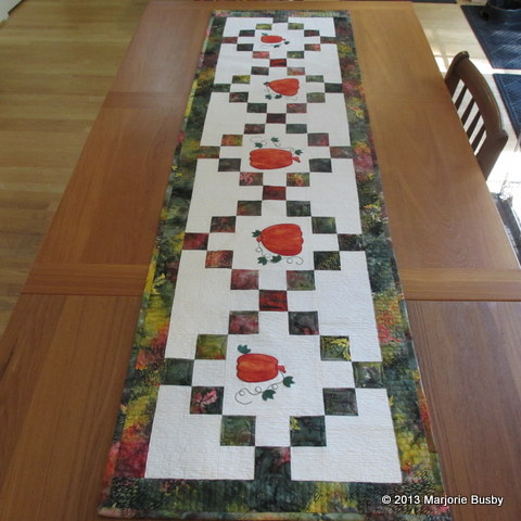 Pumpkin Table Runner Laying on Long Table