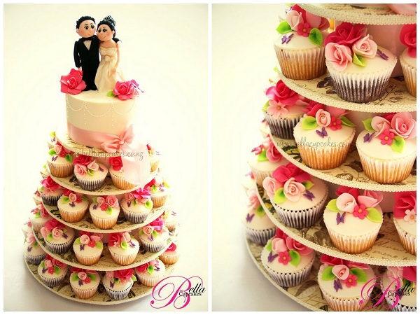 Stand Featuring Cupcake with Rosette Toppers, Wedding Cake on Top
