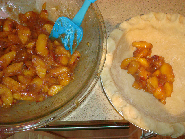 Peach Pie in Bowl, Being Scooped into Pie Crust