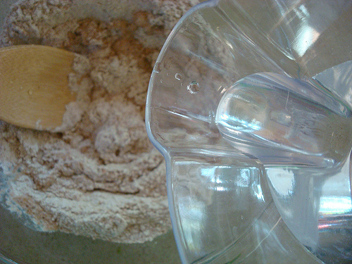 Mixing Water and Flour Together for Bread Dough