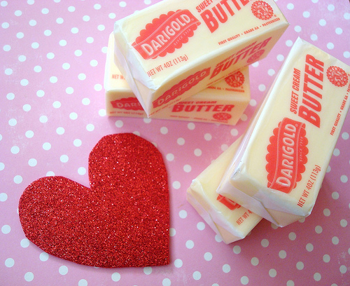 Stacks of Butter Next to Cut Out Heart