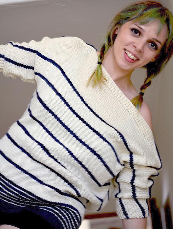 Woman Wearing Striped Knit Shirt