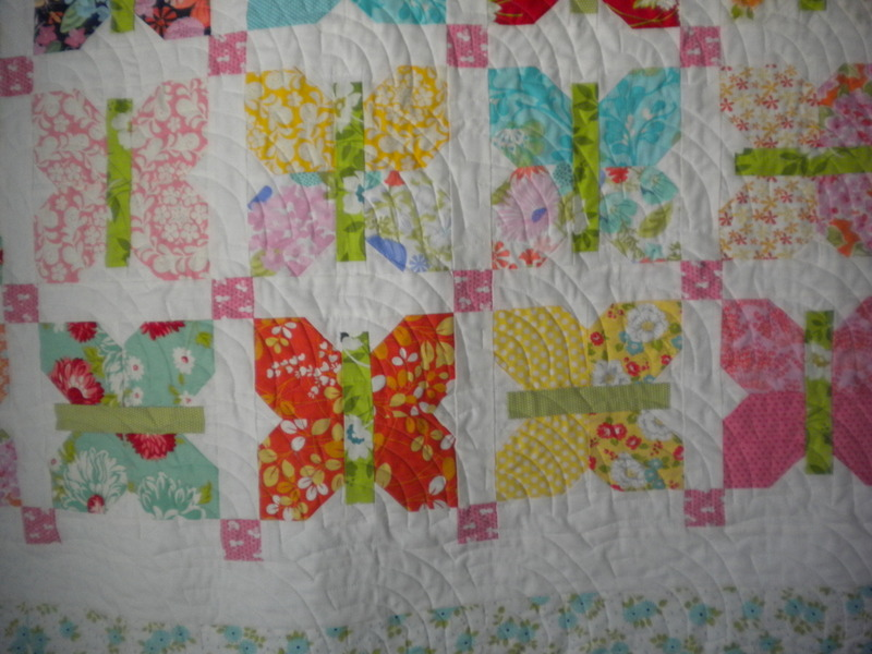 White Quilt with Colorful Patterned Butterflies